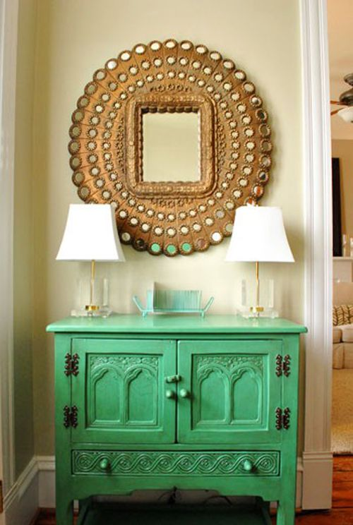 INCREDIBLE foyer - foyer design - interior design and decor - entryway table - gold peacock mirror design - Moroccan cabinet table via pinterest